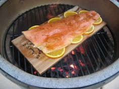 """The Art of Planking"":  Tips and tricks for making the best cedar plank grilled salmon.  Yum!"