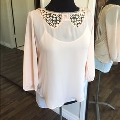 Beautiful Blouse LC Lauren Conrad. Front is 100% polyester, back is 100% Rayon.  In great condition. No stains or tears. Will also fit a small. Lt. Peach in color LC Lauren Conrad Tops Blouses