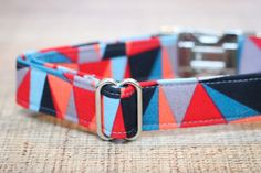 This male geometric inspired dog collar is such funky, fun addition to your favorite puppys Autumn wardrobe! The blue, gray, red & coral pattern make this a dog collar that is certain to pop and accent any fur color! Know someone you need an extra special gift for? This pet collar will fit a wide size range, small to large, (or if you need a custom size just let me know) check out the ordering directions below. Your favorite puppy will thank you! This collar has a heavy duty stabilizer sewn…