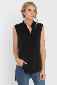 Sleeveless top is complete with a button-down front, basic collar, front slouch pocket, side slit with a longer hem in the back