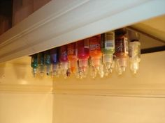 Great way to store glue and paint.  Glue magnets to the bottom of the bottle and store up side down