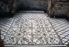 An intricate mosaic floor in Pompeii.
