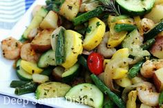 Garden Vegetable Skillet with Shrimp. A skillet meal made from the best of summer veggies - squash, zucchini, bell pepper, green beans, Vidalia onions and tomatoes, with red potatoes and fresh garden herbs and the addition of some pan-seared fresh wild-caught Gulf shrimp.