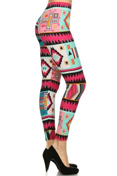 Step into spring season with our Springtastic Tribal Leggings. Mint and hues of red geometric tribal designs gorgeously color these leggings. Made from soft to the touch polyester fabric, these leggings are versatile for all day wear. These leggings feature a beautiful one of a kind print that is colorful and bold while still maintaining chic modern simplicity. Dress them up with a blouse and heels or kept casual with a vest and basic t shirt.