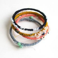 Handmade using reclaimed metal bangles, wrapped in vintage kimono fabric and hand-embroidered with vintage beads.