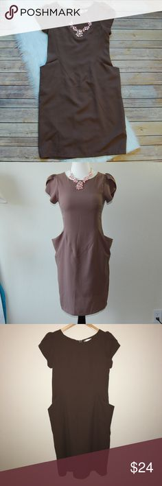 """THE NOTICE Dress Ridiculously flattering dress! Shoulder sleeve details. Wide pockets. Fitted. 100% polyester. Color is a dark tan. No sizing details but guess is a Small. Shoulder to hem is 36"""". Armpit to armpit is 15.5"""". Waist is 14.5"""".   Instagram: @bringingupsuns The Notice Dresses"""