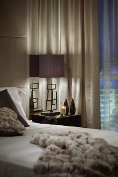 luxurious bedroom in plum and oyster | Bisha Hotel & Residences, Toronto. Interior design by Munge Leung.