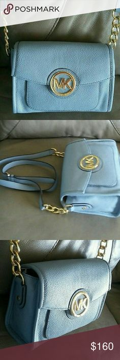 "Michael Kors Margo Small Messenger Crossbody Bag New With Tags $268 ~Color: Powder Blue  ~Genuine Pebbled Leather ~Gold tone hardware ~MK medallion logo plate on front ~Magnetic snap closure ~Two Exterior Slip Pockets (Front, Back) ~Michael Kors signature lining with 1 Slip Pocket & 1 Zip Pocket ~Strap drop 22-24"" drop, adjustable  ~9""(L), 6.5""(H), 4""(D) ~Dust bag & care card included EXTRA PICTURES LISTED IN OTHER POSTING OF THIS MICHAEL KORS MARGO Michael Kors Bags Shoulder Bags"