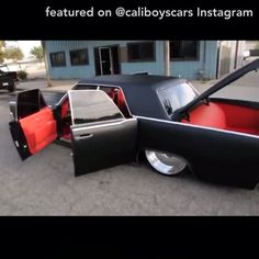 video - lincoln continental smooties matte black suicide doors bagged slammed red interior