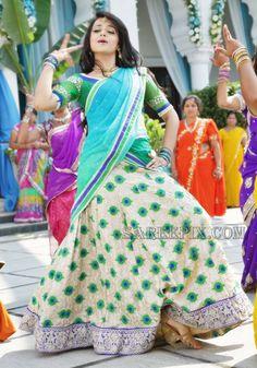 South indian actress Trisha cute dance stills in half saree. She looks beautiful in multi color and printed lehenga half sarees. Half Saree Lehenga, Indian Lehenga, Sarees, Shruti Hassan Saree, Indian Dresses, Indian Outfits, Trisha Saree, Lehenga Color Combinations, Half Saree Function