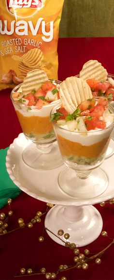 """Holiday Dip Cups: everything your Lay's Wavy chips want in a bite-sized serving! Chopped avocado, pico de gallo, sour cream and roasted red pepper hummus, yum! Perfect for when you want to share your Friday night with your friends, or for when you're just enjoying a perfect """"me moment""""."""