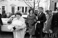 The President-elect and Jackie return to their Georgetown home, after the birth of John Jr. - December 1960.