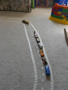 Almost Unschoolers: Masking Tape Roads - Indoor Play