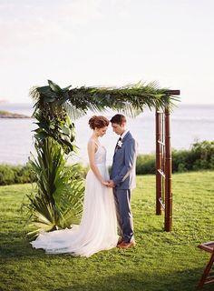 Tropical ceremony arbor | Maui Tropical Wedding Inspiration By LVL Weddings and Events | Brandon Kidd Photography