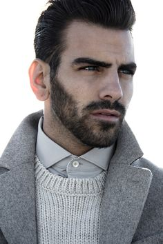 Nyle DiMarco wears coat Calvin Klein, sweater H&M and shirt Tiger of Sweden.