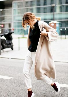 Black tee, cropped pants, sick with heels and a draped coat