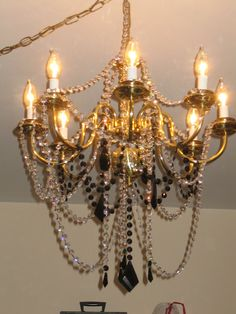 Ribbon wrapped chandelier makeover good if you cant spray paint or chandelier renovation chandelier redo crystal bling shore side farm house aloadofball Images