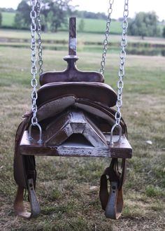 saddle horse swing- would be cute with horse head, mane, and tail! just remove saddle when not in use. Wish I'd kept my saddle! Saddle Swing, Horse Swing, Kids Saddle, Saddle Rack, Chair Swing, Boot Rack, Swinging Chair, Swing Design, Design Design