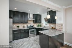 Contemporary Kitchen with High ceiling, Complex Marble Tile, Stone Tile, Raised panel, Undermount Sink, Kitchen peninsula