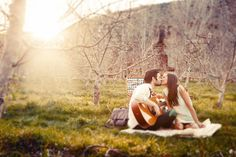 Romantic engaged couple in orchard. By Gideon Photography