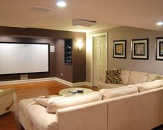 Basement--Projection TV, cozy seating. Carpet instead of hard wood. Media cabinet on side wall--add cabinet door?