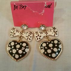 "BETSEY JOHNSON bows and hearts earrings Brand new and never worn.  Hearts are black with white polka-dot surrounded by gold tone braiding. Then hanging from white ribbons with small black flowers. Topped by rinestone post. Drop is 1 3/4"", bow is 1 1/4"" wide, heart is same width, 1"" tall. Betsey Johnson Jewelry Earrings"