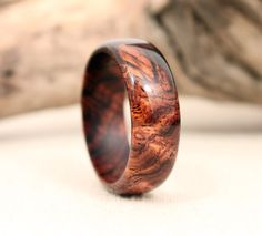 My husband wants this for his new wedding ring!  Cocobolo BURL Wooden Ring by WedgewoodRings on Etsy, $55.00