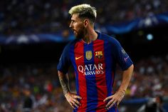 Lionel Messi of Barcelona looks on during the UEFA Champions League Group C match between FC Barcelona and Celtic FC at Camp Nou on September 13, 2016 in Barcelona, Catalonia.