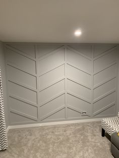 This chevron stripe wood accent wall became the central focal point in this room. Chevron Accent Walls, Wooden Accent Wall, Chevron Wall Decor, Wall Wood, Accent Walls In Living Room, Accent Wall Bedroom, Master Bedroom, Herringbone Wall, Accent Wall Designs