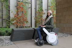 Woman seated in the Whill Model M wheelchair. Whill's Model M is an electric wheelchair meant to boost mobility for people with disabilities.