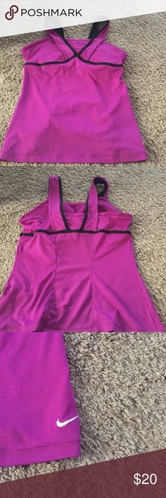 Nike Dri-Fit workout Tank Top This Tank Top has a lot of support! It comes with a attached padding bra that is sewn into the top with a waisted band. Love the color and wide straps. no Flaws! Nike Tops Tank Tops
