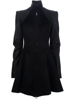 Black wool and silk blend coat from Gareth Pugh featuring a stand up collar, a front zip fastening, a contrast faux leather long sleeves and structured shoulder panel, a darted waist and an A-line skirt with an all round curtain effect.