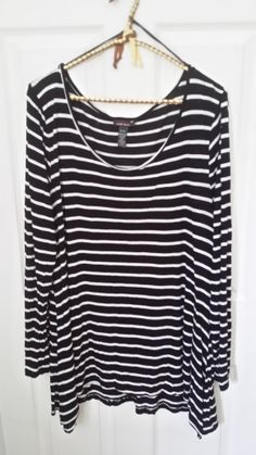 Black and White Striped top with dropped sides. Originally bought it for a costume, but is now part of my regular rotation.