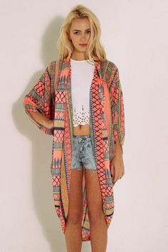 A lightweight knit cardigan featuring an open draped front and ...
