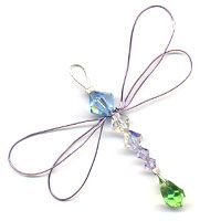 Dragonfly Suncatcher. This dazzling Dragonfly was created to hang in a sunny place. The light catches the crystals and sparkles in the sunlight. It will surely brighten up your day. Tutorial.