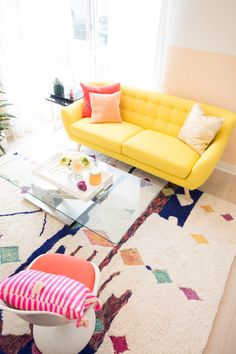 Don't shy away from having yellow, pink, and orange in the same room! These warm tones work well together to create a space that is bright and inviting!