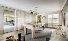 Large games room with sliding door access to the alfresco