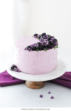 Blackberry Lime Cake – tender cake infused with lime zest, frosted with blackberry buttercream, topped with fresh blackberries and edible flowers.