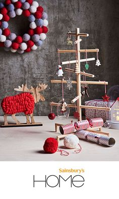 Give your home a contemporary Christmas feel this year with the Contemporary Collection from Sainsbury's Home. Shop the selection of decorations to suit the modern household including matte baubles, wooden snowflake tree decorations and a pom pom wreath. These predominantly red and wooden decorations give a modern twist on Christmas.
