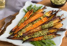 Whole roasted carrots are an easy, tasty vegetable side dish for your family. Roasting brings out their natural sweetness.