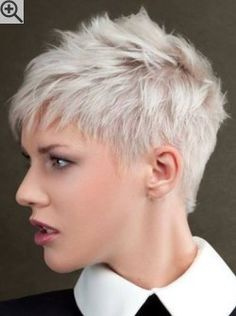 Side view of a pixie cut with layers. Featuring revealed ears and a nicely shaped nape section.