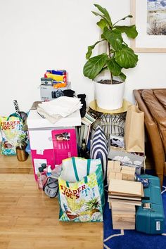 """If the prospect of a shiny new year has you wanting to jump back onboard the KonMari-method decluttering train (à la Emily Gilmore in the Netflix """"Gilmore Girls"""" revival), you're in good company. The start of 2017 has us reimagining our homes as minimalis Organisation Hacks, Home Organization, Organization Station, Apartment Therapy, Apartment Living, Living Room, Declutter Your Home, Organizing Your Home, Organizing Ideas"""