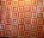 creamsicle beveled block, quilted by ideal stitches for a customer