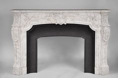 Very beautiful and important  antique Regence style fireplace in white veined Carrara marble, 19th century #fireplace #marble #mantel #19thcentury #MarcMaison #frenchantiques