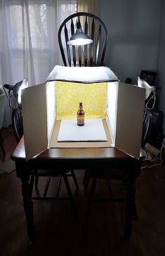 The benefit of building your own light box is that . . . you no longer need the sun to take an adequate photo. By carefully positioning three lights (with daylight bulbs -- producing a nice, cool tone) and bouncing light off fabric, you can eliminate many shadows from your shots. I get a lot of rejections from Tastespotting and Foodgawker for lighting/shadows. It makes me sad. (Robin)