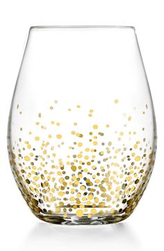 Crushing on this darling stemless wine glass that sparkles with gold dots and brings a extra festive touch to the decor.