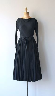 Vintage 1950s black rayon Claire McCardell dress with draped neckline, dolman sleeves, ruched and fitted waist, very full skirt, long tie sash belt and metal side zipper. --- M E A S U R E M E N T S --- fits like: extra small bust: 34-40 waist: 25 hip: free length: 50 brand/maker: Claire McCardell condition: excellent ★ layaway is available for this item to ensure a good fit, please read the sizing guide: http://www.etsy.com/shop/DearGolden/policy ✩ more vint...