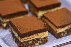 Squares of chocolate and vanilla Layered Nanaimo Bars