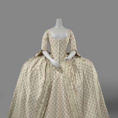 Silk robe a la Francaise ca 1780. Shown without engageants (the frilly lace at the cuffs of the sleeves). From the Dutch Rijksmuseum.