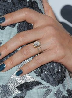 Jessica Alba's engagement ring from husband Cash Warren is a five-carat diamond with a gold pavé diamond band.